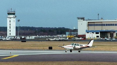 A plane prepares to take off at Hanscom Field in Bedford.
