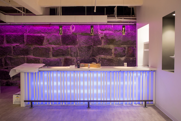 The bar area, still under construction, complete with LED lighting that can be controlled from an iPad.  (Aram Boghosian for The Boston Globe)